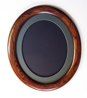 oak oval stained dark brown shown with oval green mat