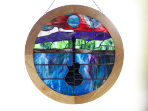 Round Frame Made Of Oak With A Light Stain.