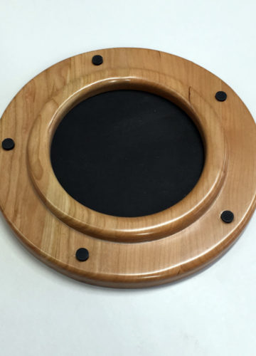 Porthole style round frame is small enough to work anywhere.