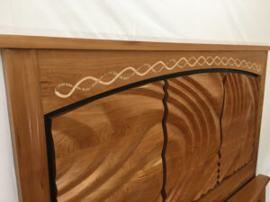 Example of maple and zebra inlay marquetry on headboard