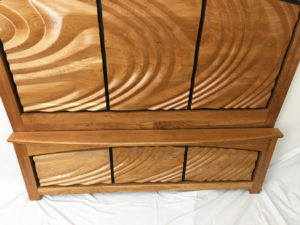 Hand carved head board and foot board set made of cherry